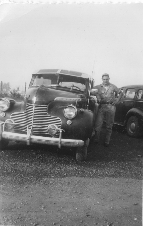 Grandfather_leaning_on_car